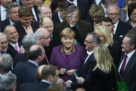 German Chancellor Angela Merkel (C) and fellow parliamentarians get ready to vote on financial help for Greece at the lower house of parliament, the Bundestag in Berlin, November 30, 2012. REUTERS/Thomas Peter