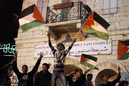 Palestinians wave Palestinian flags as they take part in a rally in the West Bank city of Bethlehem November 29, 2012. REUTERS/Ammar Awad