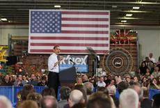U.S. President Barack Obama speaks at the Rodon Group, a manufacturer of toys in Hatfield, Pennsylvania, November 30, 2012. Obama pushed for congress to resolve the issue of U.S. debt and Bush-era tax cuts that are set to expire at the end of the year. REUTERS/Jason Reed