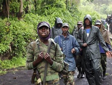 M23 rebel fighters walk as they withdraw near the town of Sake, some 42 km (26 miles) west of Goma November 30, 2012. REUTERS/Goran Tomasevic