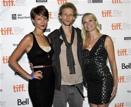(L-R) Cast members Gretchen Lodge, Johnny Lewis and Alexandra Holden pose at the screening of the film ''Lovely Molly'' at the 36th Toronto International Film Festival September 14, 2011. REUTERS/Mike Cassese