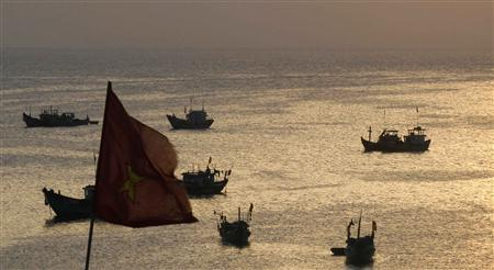 Fishing boats are seen in the bay of the Ly Son islands of Vietnam's central Quang Ngai province, in this file picture taken April 10, 2012. China said on November 30, 2012, that it attached great importance to freedom of navigation in the South China Sea after state media said police in its southern island province of Hainan will board and search ships which illegally enter what China considers its territory in the disputed waters. REUTERS/Kham/Files