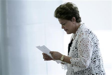 Brazil's President Dilma Rousseff reads a piece of paper at an event for the announcement of measures to expand the Affectionate Brazil Program, which aims to fight poverty, in Brasilia November 29, 2012. REUTERS/Ueslei Marcelino