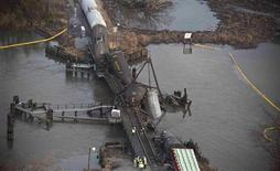 Derailed freight train cars sit semi-submerged in the waters of Mantua Creek after a train crash in Paulsboro, New Jersey November 30, 2012. A rail bridge collapsed on Friday over a creek in southern New Jersey, causing a Conrail freight train to derail and spill hazardous chemicals into the air and water, authorities said. REUTERS/Andrew Burton