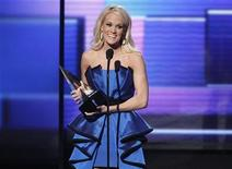"Carrie Underwood accepts the award for favorite country album for ""Blown Away"" at the 40th American Music Awards in Los Angeles, California, November 18, 2012. REUTERS/Danny Moloshok"