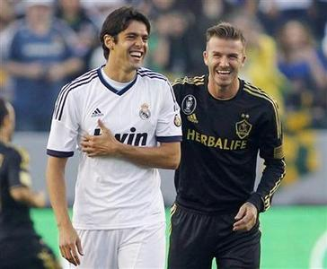 Real Madrid's Kaka (L) and Los Angeles Galaxy's David Beckham (R) share a laugh before their World Football Challenge international friendly soccer match in Carson, California August 2, 2012. REUTERS/Danny Moloshok/Files