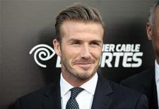 David Beckham quiere jugar una última vez en la Liga de Campeones antes de colgar las botas una vez abandone Los Ángeles tras cinco años en los Galaxy. En la imagen de archivo, Beckam posa para los fotógrafos durante un acto público en California el pasado 1 de octubre. REUTERS/Jason Redmond