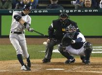 New York Yankees Ichiro Suzuki connects for a single against the Detroit Tigers during the seventh inning during Game 3 in their MLB ALCS baseball playoff series in Detroit, Michigan, October 16, 2012. REUTERS/Mark Blinch
