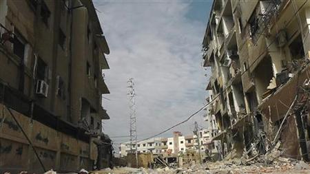A view of buildings damaged by what activists said were missiles fired by a Syrian Air Force fighter jet loyal to Syria's President Bashar al-Assad in Daria, near Damascus, November 30, 2012. REUTERS/Kenan Al-Derani/Shaam News Network/Handout