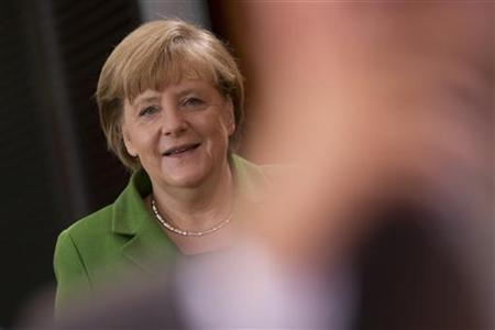 German Chancellor Angela Merkel arrives at a cabinet meeting at the Chancellery in Berlin November 28, 2012. REUTERS/Thomas Peter