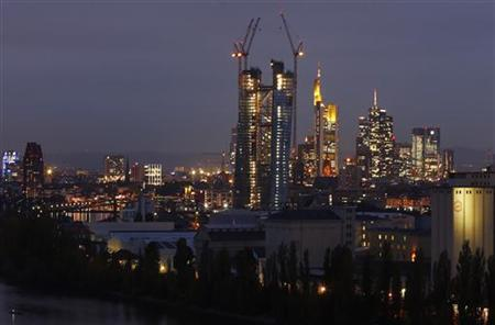 The construction site of the new headquarters of the European Central Bank (ECB) (C) is seen in front of the city's skyline with its banking towers, in Frankfurt, late October 11, 2012. REUTERS/Kai Pfaffenbach (GERMANY - Tags: BUSINESS CITYSPACE)