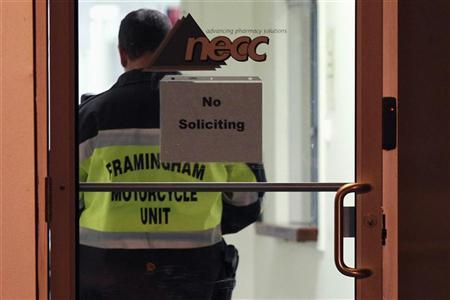 A Framingham Motorcycle Unit officer stands by while federal agents search New England Compounding Center in Framingham, Massachusetts October 16, 2012. The pharmaceutical compounding company is a producer of the steroid methylprednisolone acetate, which is a drug linked to a rare form of meningitis that has killed 16 people and sickened more than 200 others, the Virginia Department of Health said in a statement on Tuesday. REUTERS/Dominick Reuter