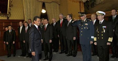 Mexico's new President Enrique Pena Nieto (L) joins his newly sworn-in cabinet members for an official photograph at the Palacio Nacional in Mexico City December 1, 2012. REUTERS/Presidencia de Mexico/Handout