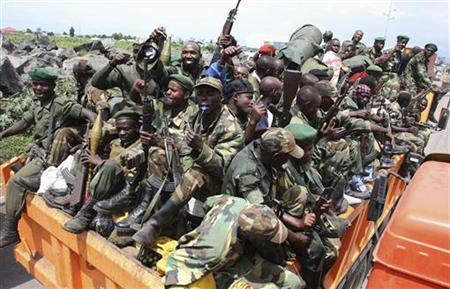 M-23 rebel fighters are transported on a truck as they withdraw from Goma December 1, 2012. REUTERS/Goran Tomasevic