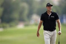 Martin Kaymer of Germany walks on the 15th green during the second round of the DP World Tour Championship at Jumeirah Golf Estates in Dubai, November 23, 2012. REUTERS/Nikhil Monteiro