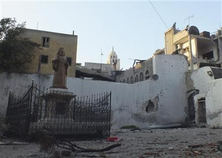A view shows damages outside a Jesuit church in Homs November 30, 2012. REUTERS/Yazan Homsy