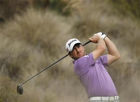 Graeme McDowell of Northern Ireland tees off on the 14th hole during the third round of the World Challenge golf tournament in Thousand Oaks, California, December 1, 2012. REUTERS/Lucy Nicholson