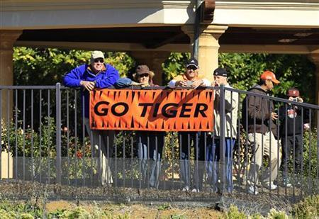 Fans hang a banner in support of U.S. golfer Tiger Woods from their home in Sherwood Country Club during the third round of the Chevron World Challenge PGA golf tournament in Thousand Oaks, California December 3, 2011. REUTERS/Lucy Nicholson