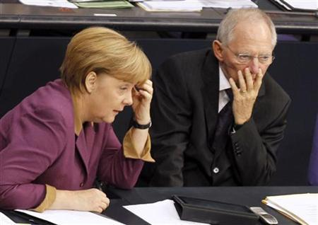 German Chancellor Angela Merkel and Finance Minister Wolfgang Schaeuble wait to vote on financial help for Greece at the lower house of parliament, the Bundestag, in Berlin November 30, 2012. REUTERS/Wolfgang Rattay