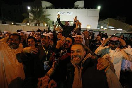 Newly elected member of Parliament Yousef Zalzaly (top C), a Shi'ite Muslim, is greeted by supporters after the final results of the election were announced in Kuwait city December 1, 2012. REUTERS/Jamal Saidi/