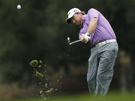 Graeme McDowell of Northern Ireland hits a shot on the 18th fairway during the third round of the World Challenge golf tournament in Thousand Oaks, California, December 1, 2012. REUTERS/Lucy Nicholson