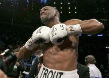 Austin Trout celebrates after beating Miguel Cotto in their Super Welterweight World Championship fight at Madison Square Garden in New York, December 1, 2012. REUTERS/Ray Stubblebine