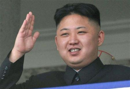 North Korea leader Kim Jong-un smiles as he salutes during a military parade to celebrate the centenary of the birth of North Korea founder Kim Il-sung in Pyongyang in this photo taken by Kyodo on April 15, 2012. REUTERS/Kyodo/Files