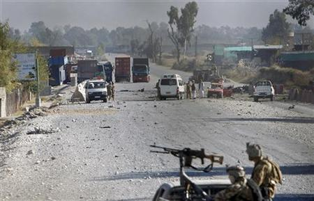 Afghan security forces inspect the site of an attack in Jalalabad December 2, 2012. REUTERS/ Parwiz