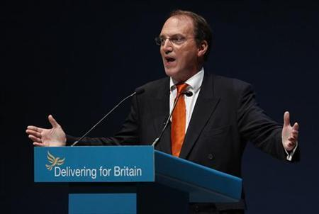 Simon Hughes, the deputy leader of the Liberal Democrat Party, gestures as he delivers his speech at his party's conference in Liverpool, northern England, September 21, 2010. REUTERS/Phil Noble/Files