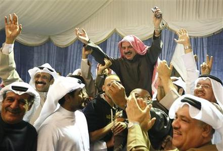 Newly-elected Member of Parliament Abdallah al Maayouf is carried by supporters, after final results of election are announced, in Kuwait city December 1, 2012. REUTERS/Jamal Saidi
