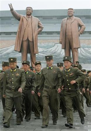 North Korean soldiers walk past bronze statues of North Korea founder Kim Il-sung (L) and late leader Kim Jong-il in Pyongyang, in this photo taken by Kyodo April 25, 2012, during a ceremony to mark the 80th anniversary of the founding of the Korean People's Army. Mandatory Credit REUTERS/Kyodo FOR EDITORIAL USE ONLY. NOT FOR SALE FOR MARKETING OR ADVERTISING CAMPAIGNS. THIS IMAGE HAS BEEN SUPPLIED BY A THIRD PARTY. IT IS DISTRIBUTED, EXACTLY AS RECEIVED BY REUTERS, AS A SERVICE TO CLIENTS. MANDATORY CREDIT. JAPAN OUT. NO COMMERCIAL OR EDITORIAL SALES IN JAPAN