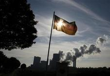 Germany's national flag flutters over the Niederaussem coal power plant of RWE Power, one of Europe's biggest electricity and gas companies in Rheidt north-west of Cologne October 11, 2012. REUTERS/Wolfgang Rattay