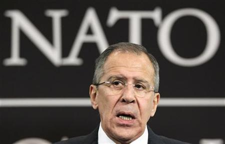 Russia's Foreign Minister Sergei Lavrov holds a news conference after a NATO-Russia foreign ministers meeting at the Alliance headquarters in Brussels December 8, 2011. REUTERS/J. Scott/Files
