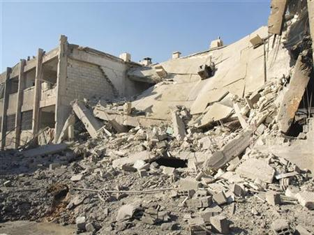 A general view of buildings, damaged by what activists said were missiles fired by a Syrian Air Force fighter jet loyal to President Bashar al-Assad, in Daria near Damascus December 1, 2012. REUTERS/Fadi Al-Derani/Shaam News Network/Handout