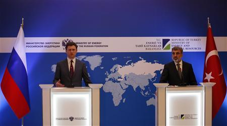 Russia's Energy Minister Alexander Novak (L) speaks as his Turkish counterpart Taner Yildiz listens during a news conference in Istanbul December 2, 2012. REUTERS/Murad Sezer