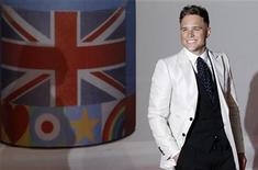 British singer Olly Murs arrives for the BRIT Music Awards at the O2 Arena in London February 21, 2012. REUTERS/Luke MacGregor