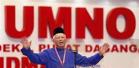 Malaysia's Prime Minister Najib Razak delivers his keynote address during the opening of his ruling United Malays National Organisation's (UMNO) annual gathering in Kuala Lumpur November 29, 2012. REUTERS/Bazuki Muhammad