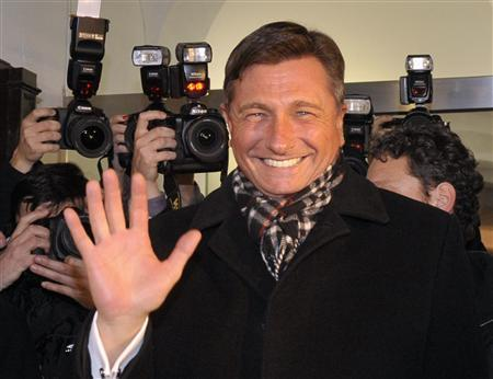 Former prime minister Borut Pahor celebrates his victory with supporters after the unofficial results were announced in the second round of Presidential elections in Ljubljana December 2, 2012. REUTERS/Srdjan Zivulovic