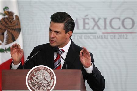 Mexico's President Enrique Pena Nieto gestures during the National Sports Award ceremony at Los Pinos Presidential Palace in Mexico City December 2, 2012. REUTERS/Edgard Garrido