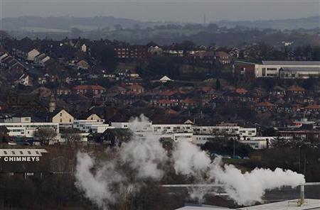 Smoke rises from a factory in Stoke-on-Trent, central England, January 25, 2012. REUTERS/Darren Staples