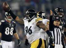 Pittsburgh Steelers defensive end Ziggy Hood (C) comes up with a fumble recovery against Baltimore Ravens quarterback Joe Flacco (not in photo) during the second half of their NFL football game in Baltimore December 2, 2012. REUTERS/Gary Cameron