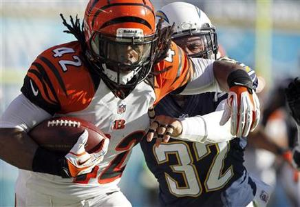 Cincinnati Bengals running back BenJarvus Green-Ellis (42) is pushed out-of-bounds by San Diego Chargers free safety Eric Weddle (32) after a 41-yard run in the first half of their NFL football game in San Diego, California December 2, 2012. REUTERS/Alex Gallardo