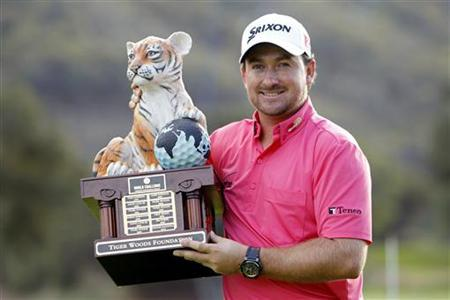 Graeme McDowell of Northern Ireland poses with his trophy after winning the World Challenge golf tournament in Thousand Oaks, California, December 2, 2012. REUTERS/Danny Moloshok