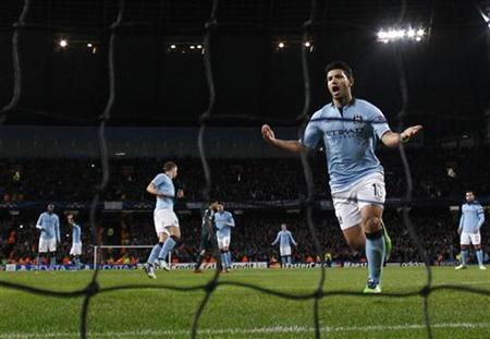 Manchester City's Sergio Aguero celebrates after scoring a penalty against Real Madrid during their Champions League Group D soccer match at The Etihad Stadium in Manchester, northern England November 21, 2012. REUTERS/Phil Noble