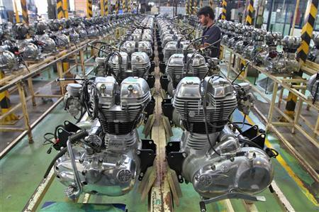 A worker assembles an engine inside the Royal Enfield motorcycle factory in Chennai April 6, 2012. Picture taken April 6, 2012. REUTERS/Babu/Files