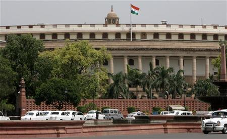 Indian lawmakers arrive in their cars at the parliament on the opening day of the budget session in New Delhi July 2, 2009. REUTERS/B Mathur/Files