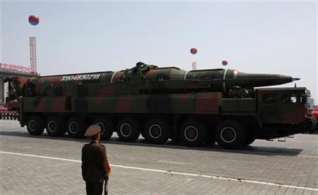 A rocket is carried by a military vehicle during a military parade to celebrate the centenary of the birth of Kim Il-sung in Pyongyang April 15, 2012. REUTERS/Bobby Yip/Files