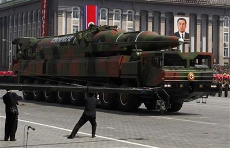 State media film a rocket carried by a military vehicle during a military parade to celebrate the centenary of the birth of Kim Il-sung in Pyongyang April 15, 2012. REUTERS/Bobby Yip/Files