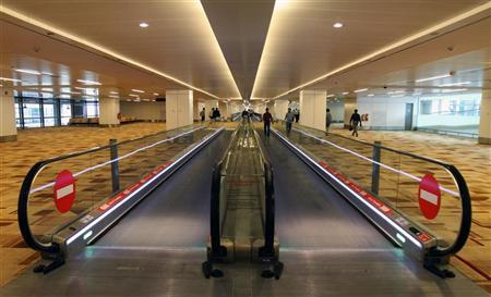 Passengers walk inside the newly constructed T3 terminal of Indira Gandhi International Airport in New Delhi July 15, 2010. REUTERS/B Mathur/Files