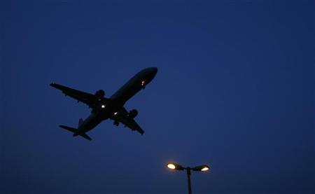 An aeroplane prepares to land at an airport in New Delhi June 4, 2008. REUTERS/Adnan Abidi/Files